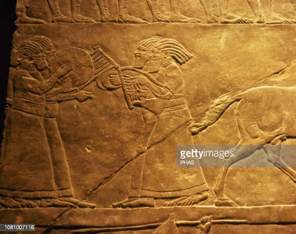 Palace of Ashurbanipal Nineveh Iraq Relief detail Music scene Upper Mesopotamia NeoAssyrian Empire 7th century BC Louvre Museum Paris France
