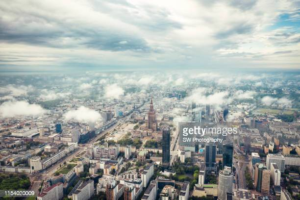 palace of culture and science in the cloud - poland stock pictures, royalty-free photos & images