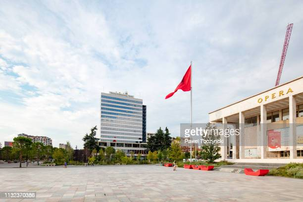 palace of culture and tiran international hotel on skanderbeg square in central tirana, albania, 2018 - socialism stock pictures, royalty-free photos & images