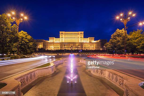 palace of parliament at night - romania stock pictures, royalty-free photos & images