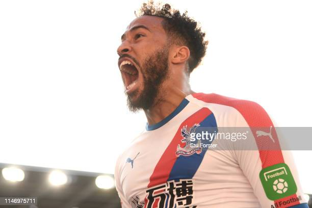 Palace player Andros Townsend celebrates after scoring the third goal during the Premier League match between Cardiff City and Crystal Palace at...
