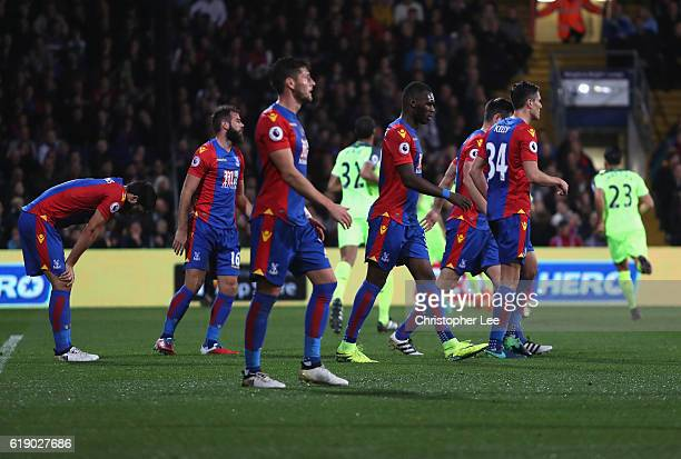 Palace players look dejected after the second goal uring the Premier League match between Crystal Palace and Liverpool at Selhurst Park on October 29...