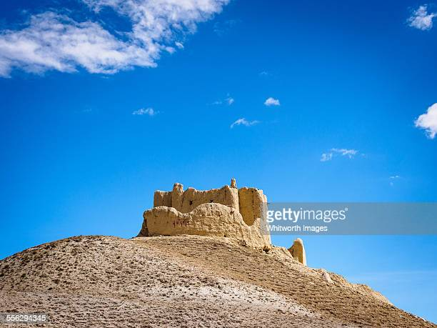 palace ruins on hill above lo manthang nepal - lo manthang stock pictures, royalty-free photos & images