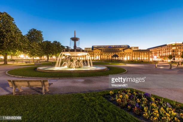 palace square with fountain in front of koenigsbau at dusk, stuttgart, germany - castle square stock pictures, royalty-free photos & images