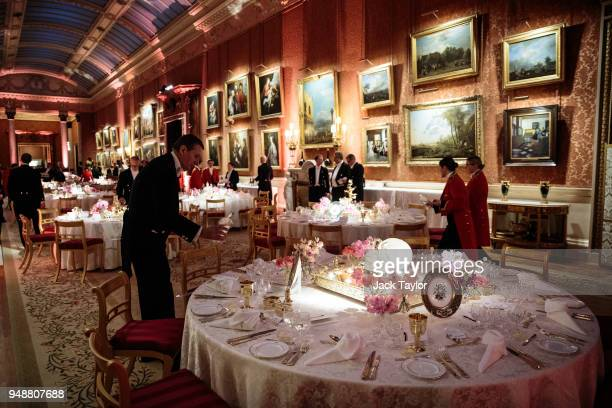 Palace staff prepare the tables ahead of the Queen's Dinner at Buckingham Palace in the week of the 'Commonwealth Heads of Government Meeting' on...
