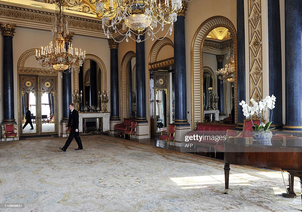 WEBSITES Palace Steward Nigel McEvoy, walks through the Music Room, which will be used during the wedding reception of Prince William and Kate Middleton, at Buckingham Palace in London on March 25, 2011. The second-in-line to the throne marries his university sweetheart on April 29 at Westminster Abbey, in an event that has become a global media sensation ever since they announced their engagement last November.AFP PHOTO/WPA POOL/Nick Ansell
