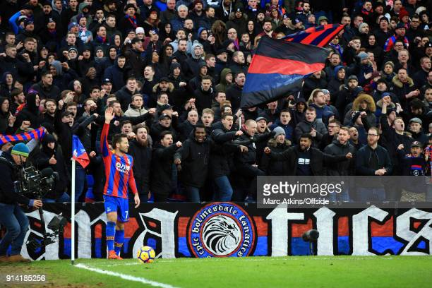 Palace Ultras look on as Yohan Cabaye takes a corner during the Premier League match between Crystal Palace and Newcastle United at Selhurst Park on...