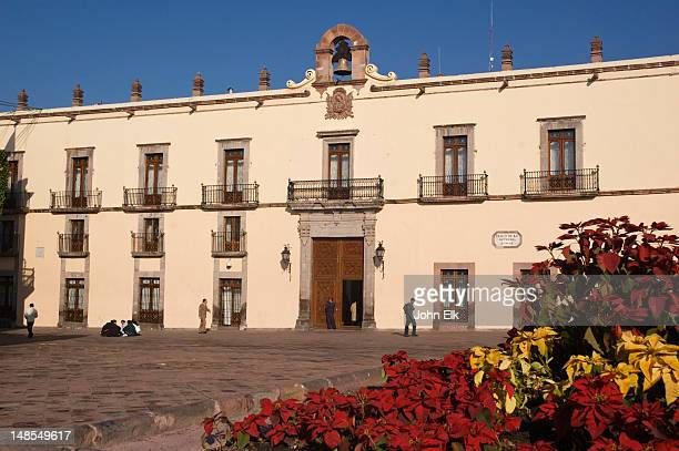 palacio de gobierno, government palace with poinsettias - queretaro state stock pictures, royalty-free photos & images