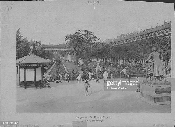 PalaisRoyal Gardens popular ornamental gardens in Paris with the lawns and promenade being used by visitors of all ages Paris circa 19001920