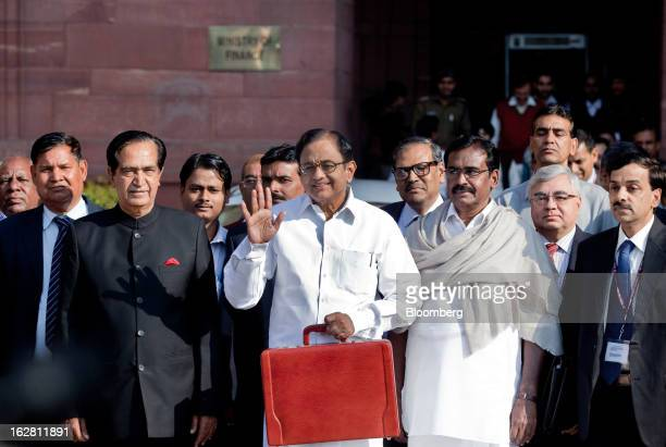 Palaniappan Chidambaram India's finance minister center gestures as he stands in front of the ministry of finance with his team on his way to present...