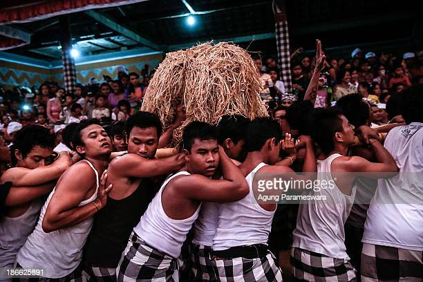 Palanquin bearers brace for a collision with the other palanquins during Dewa Masraman Ritual on November 2 2013 at Paksabali village in Klungkung...