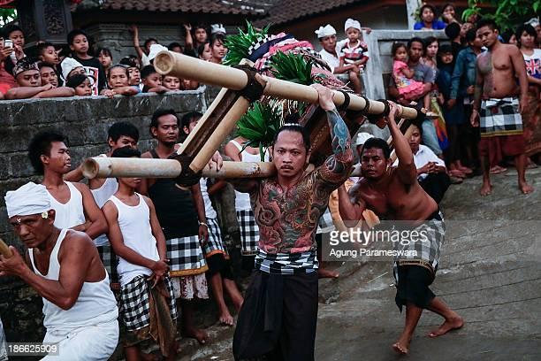 Palanquin bearers dance during Dewa Masraman Ritual on November 2 2013 at Paksabali village in Klungkung Regency Bali Indonesia The Dewa Masraman...