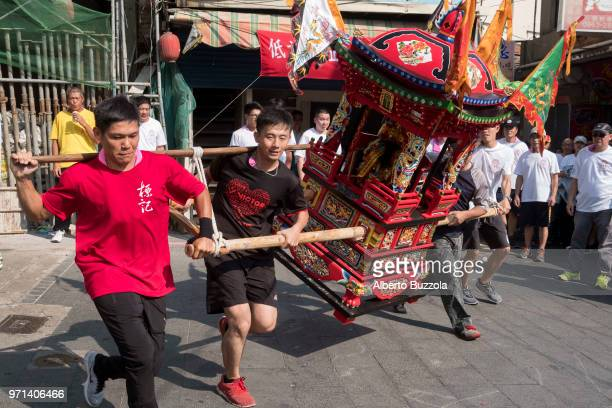 A palanquin carrying one of the hundreds Gods of the Taoist pantheon is taken around the island streets in occasion of the Ing Chen Huang Festival...