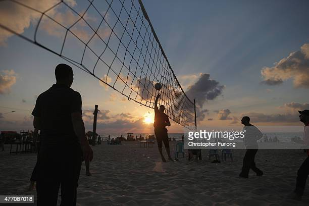 Palastinian men play volleyball on Gaza beach on June 13 2015 in Gaza City Gaza Palestinians are taking the opportunity to relax and enjoy picnics on...