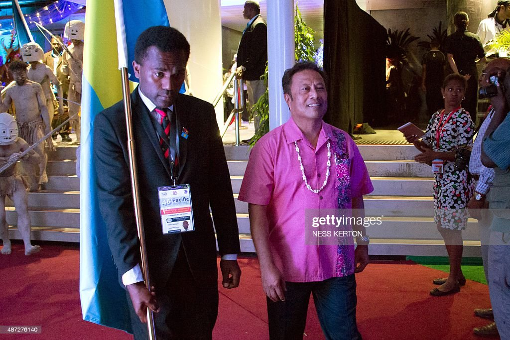 Palau President Tommy Rememgesau (C) arrives for the official opening of the 46th Pacific Islands Forum (PIF) in Port Moresby on September 8, 2015. The 16-nation grouping consists mainly of small island nations, together with Australia and New Zealand, with the two developed nations being accused of dragging their feet on climate change. AFP PHOTO/Ness KERTON