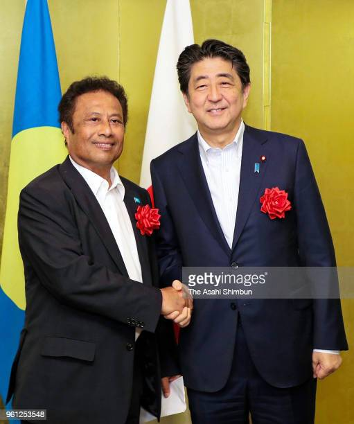Palau President Tommy Remengesau and Japanese Prime Minister Shinzo Abe shake hands prior to their bilateral meeting on the sidelines of the Pacific...
