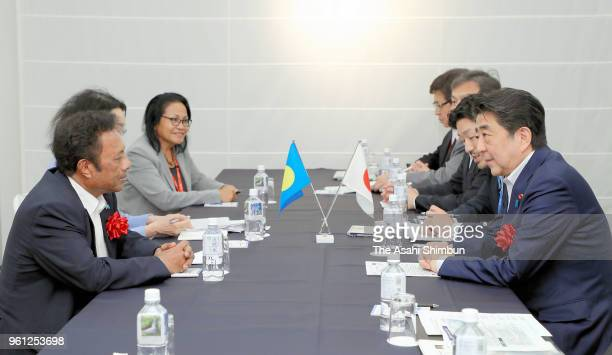 Palau President Tommy Remengesau and Japanese Prime Minister Shinzo Abe talk during their bilateral meeting on the sidelines of the Pacific Alliance...