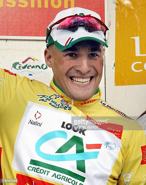 Italian Angelo Furlan celebrates on the podium after winning the first stage of the Etoile de Besseges cycling race between Pezenas and Palavas...