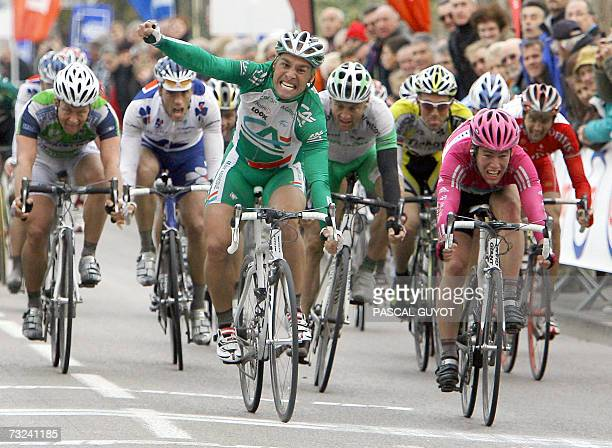 Italian Angelo Furlan clenches a fist as he crosses the finish line to win the first stage of the Etoile de Besseges cycling race between Pezenas and...