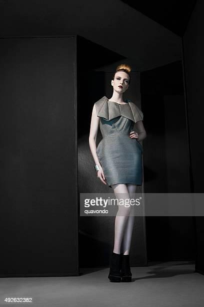 Pale fashion model on dark background