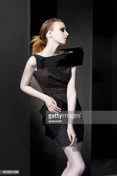 Pale fashion model posing for camera