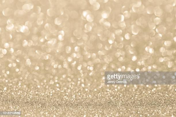 pale gold glitter background - glamour stock-fotos und bilder