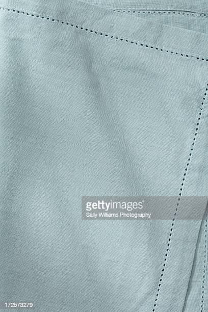 A pale green rippled napkin background