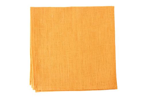Pale orange textile napkin on white 653973152