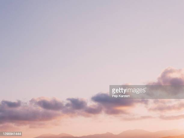 pale purple and clouds in tranquil sunset sky - alpes maritimes stock pictures, royalty-free photos & images