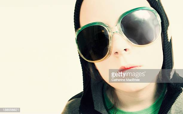 pale skinned boy wearing large dark sunglasses - catherine macbride stock pictures, royalty-free photos & images