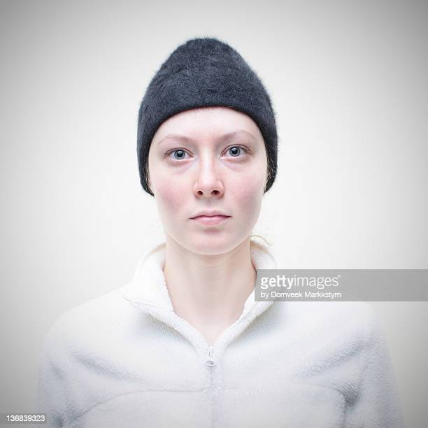 pale woman black hat, white sweater - knit hat stock pictures, royalty-free photos & images