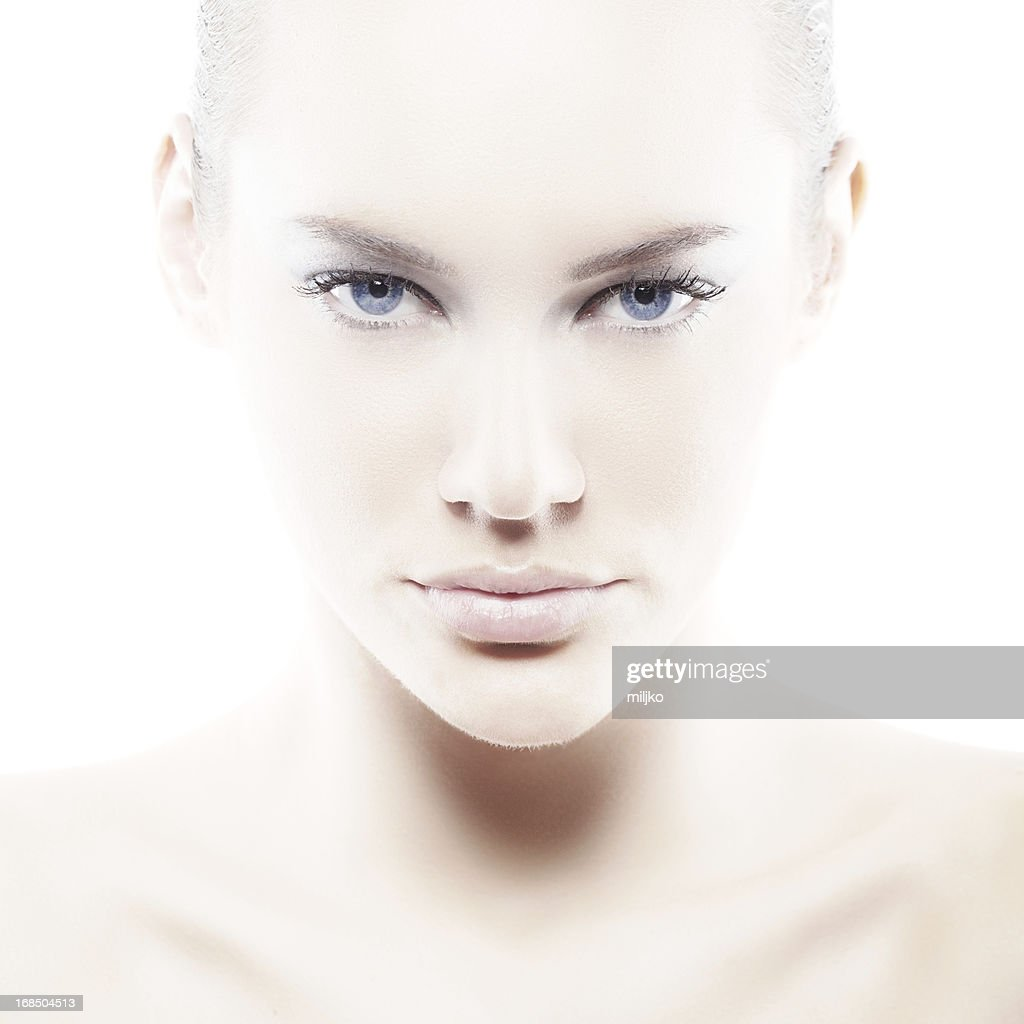 Pale woman with blue eyes on white : Stock Photo