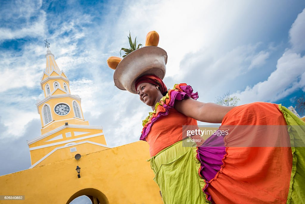 Palenquera selling fruits in Cartagena : Stock Photo