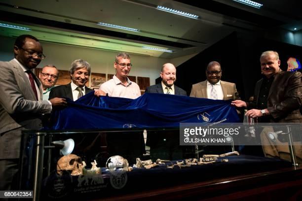 Paleoanthropologist and National Geographic ExplorerinResidence Professor Lee Rogers Berger Gauteng Premier David Makhura Professor Johan Hawks from...