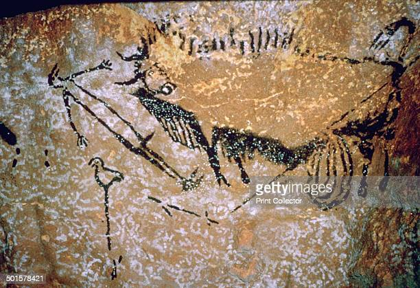 Paleolithic cavepainting of a Bison and Man from Lascaux