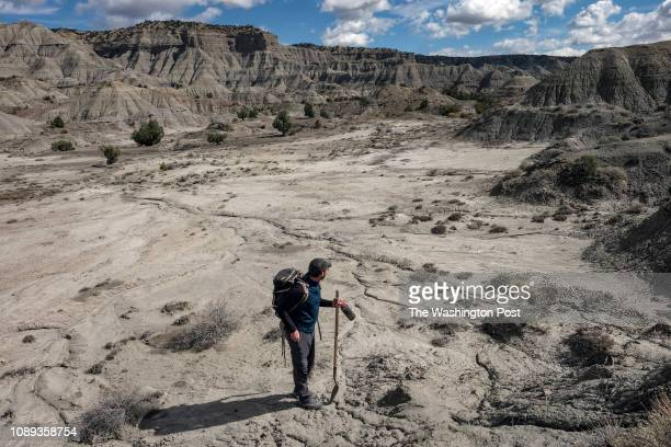 Paleontologist Randy Irmis makes his way to a newly discovered dinosaur site in Grand Staircase Escalante National Monument in Garfield County UT on...