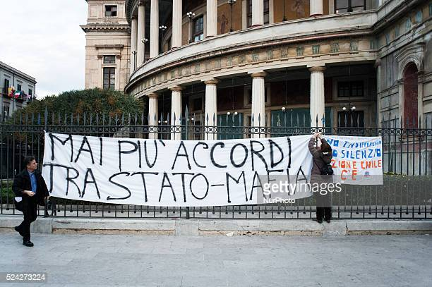 Palermo Dec 20 2013 A woman is hanging up a protest banner that reads' No more StateMafia negotiations' People demonstrated to show support for...