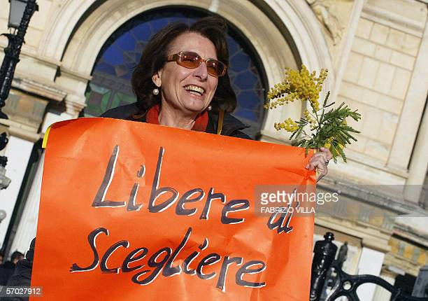 Sicilian woman shows mimosa flowers during a manifestation 08 March 2006. Hundreds of women marched through the Sicilian capital Palermo to highlight...