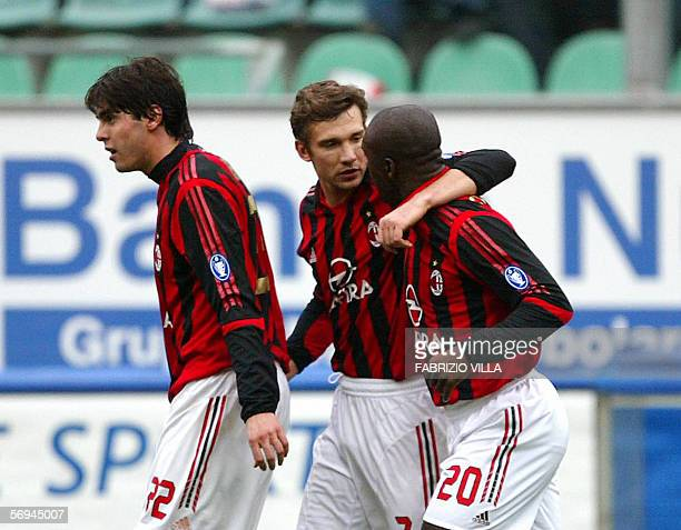Milan's players Kaka Andriy Shevchenko and Clarence Seedorf celebrate after scoring a second goal againt Palermo during their football match at Renzo...
