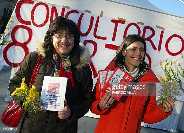 Sicilian women shows mimosa flowers during a demonstration 08 March 2006. Hundreds of women marched through the Sicilian capital Palermo to highlight...