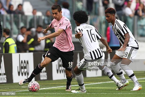 Palermo midfielder Ivajlo Cocev fights for the ball against Juventus forward Juan Cuadrado during the Serie A football match n33 JUVENTUS PALERMO on...