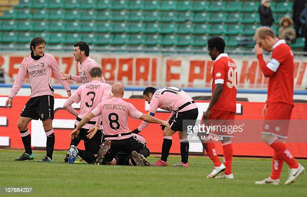 Palermo players celebrate Josip Ilicic's opening goal during the Serie A match between Bari and Palermo at Stadio San Nicola on December 19 2010 in...