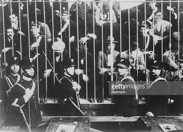 Palermo Sicily Italy Members of the Mafia handcuffed and guarded behind bars await trial after their capture