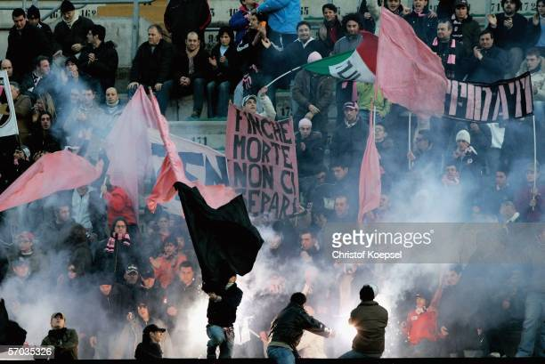 Palermo supporters launch flares during the UEFA Cup Round of 16 first leg match between Palermo and Schalke 04 at the Stadium Renzo Barbera on March...