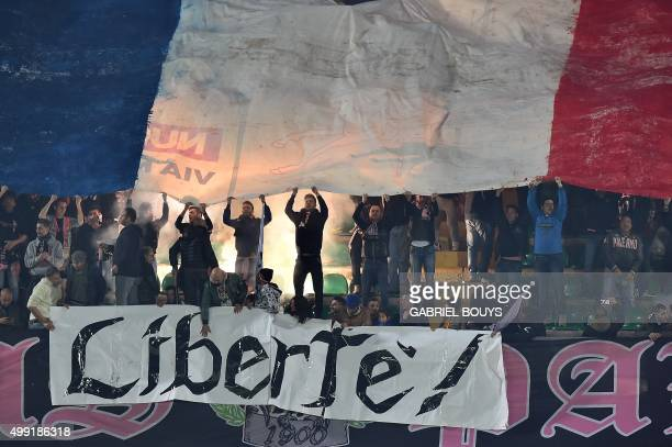 Palermo's fans deploy a giant French flag during the Italian Serie A football match between Palermo and Juventus on November 29, 2015 at the Renzo...