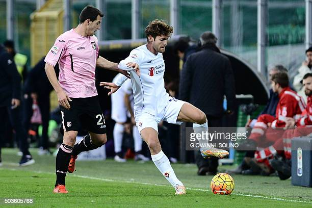Palermo's midfielder from Croatia Mato Jajalo vies with Fiorentina's defender from Spain Marcos Alonso Mendoza during the Italian Serie A football...