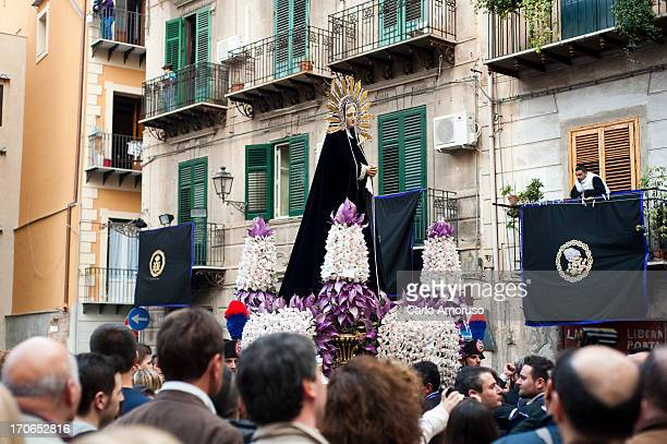 CONTENT] PalermoSicily Italy 31 March 2013 Easter procession worshippers carry a statue of Mary the mother of Jesus