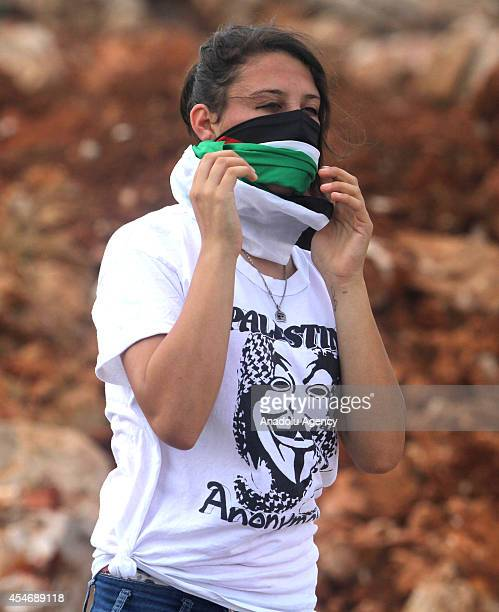 Palesitinan female demonstrator takes part in a protest against the expropriation of Palestinian land by Israel and the Israeli Wall of Shame the...