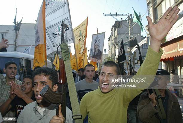 Palestinain man chants slongans in support of Palestinian leader Yasser Arafat during a rally in the Nuseirat refugee camp in the center Gaza Strip...