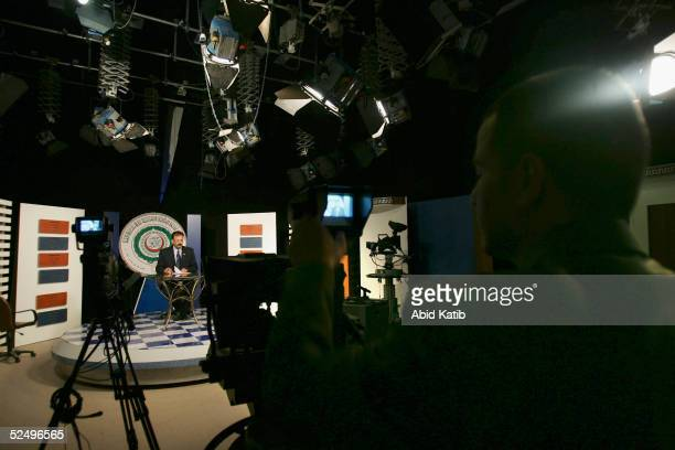 Palestinain news broadcaster Mohammad ALBaz presents a news bulletin on the official Palestinian Satellite Channel March 22 in Gaza City Gaza Strip...